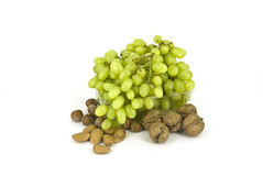 Grapes. Grape branch in plastic bottles with nuts Royalty Free Stock Images