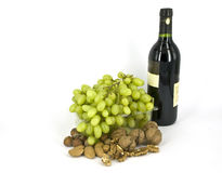 Grapes. Grape branch in plastic bottles with nuts Royalty Free Stock Image