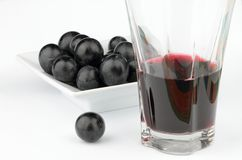 Grapes. On plate with glass of juice Stock Photos