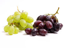 Grapes. White and purple grapes on white Stock Image