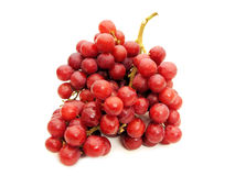 Grapes. A bunch of red grapes against a white background Stock Image