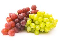 Grapes. Colorful grapes isolated over white background Royalty Free Stock Photo