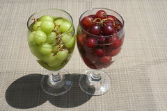 Grapes. Two glasses filled with red and green grapes Stock Photo