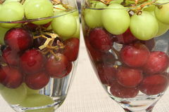 Grapes. Two glasses filled with red and green grapes Stock Photography