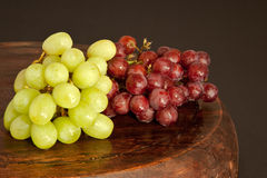 Grapes. Bunches of fresh grapes on a wooden surface Royalty Free Stock Photography
