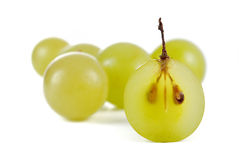 Grapes. And halved grape isolated on white Royalty Free Stock Photo