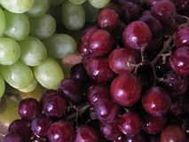 Grapes. Clusters of red and green grapes stock images