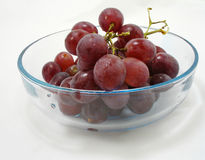 Grapes. Red grapes in a clear bowl Royalty Free Stock Photo