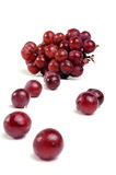 Grapes. Bunch of real grapes and some grapes out of bunch royalty free stock photo