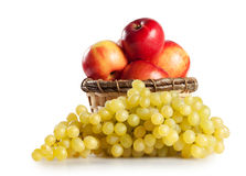 Grapes and apples in a basket Royalty Free Stock Image