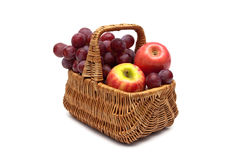 Grapes and apples in a basket on a white background Stock Image