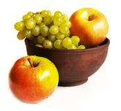 Grapes and apples in the clay plate Royalty Free Stock Photos