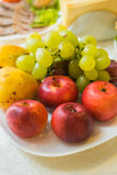Grapes, apples and pears on a plate Royalty Free Stock Photos