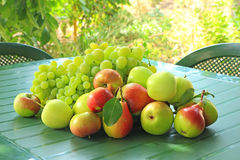 Grapes, apples and pears on a table Stock Photography