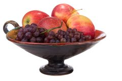 Grapes apples in a vase Royalty Free Stock Images