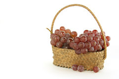 Grapes in a backet. Delaware grapes in a wicker backet Royalty Free Stock Photo
