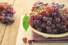 Grapes on bamboo basket. Royalty Free Stock Photos