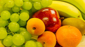 Grapes, bananas, apples, apricots and oranges royalty free stock photos