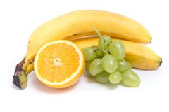 Grapes, bananas and orange. On a white background Stock Photo
