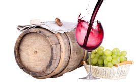 Grapes on a barrel with corkscrew and wine glass Royalty Free Stock Image