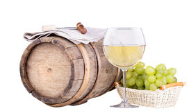 Grapes on a barrel with corkscrew and wine glass Royalty Free Stock Photography