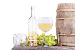 Grapes on a barrel with corkscrew and wine glass Stock Photography