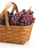 Grapes in the basket. Red fresh organic grape basket pottle isolated Stock Photography