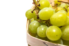 Grapes in a basket isolated on white Stock Photo