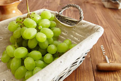 Grapes in a basket. On an old wooden table Stock Photo