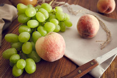 Grapes in a basket. On an old wooden table Stock Image