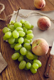 Grapes in a basket. On an old wooden table Royalty Free Stock Image