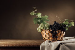 Grapes in a basket still life Royalty Free Stock Image