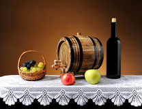 Grapes in a basket wicker and wooden barrel Stock Photo