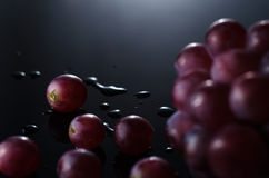 Grapes in Black. Bunch of Grapes in Black Background royalty free stock image