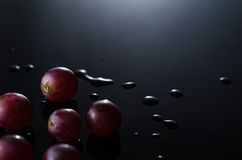 Grapes in Black. Pieces of Grapes Isolated in Black background Stock Photo