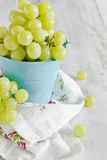 Grapes in a blue  bucket Royalty Free Stock Images