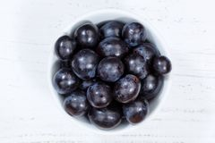 Grapes blue fruits fruit from above bowl wooden board royalty free stock photography