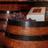 Grapes and Bottle Box on Fine Big Wine Wooden Barrel Stock Image