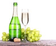 Grapes  with bottle of champagne and glass Stock Images