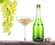 Grapes  with bottle of champagne and glass Stock Photo