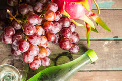 Grapes and a bottle of juice Stock Images