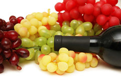 Grapes and bottle of wine Royalty Free Stock Photo