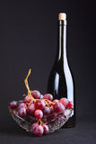 Grapes. Bottle with wine Royalty Free Stock Photo