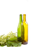 Grapes and bottles on white Stock Photo