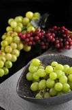Grapes in Bowl on Black Background Stock Photos