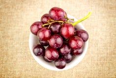 Grapes in bowl on hessian burlap background. Detailed studio shot stock photo