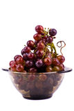 Grapes in bowl isolated on white Royalty Free Stock Images