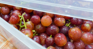 Grapes in a box. Grapes in  box with a  in selective focus Royalty Free Stock Image