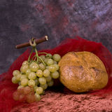 Grapes and bread. A bunch of white grapes and a big bread stock images