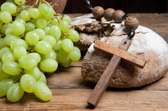 Grapes and broken bread Stock Image